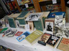 A large quantity of books relating to Mahatma Gandhi.