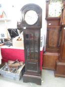 A mahogany Grandmother clock.
