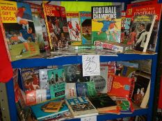 A very interesting lot of football memorabilia on 2 shelves, in excess of 40 books in total,