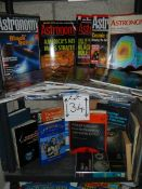 Two shelves of astronomy related books and magazines.