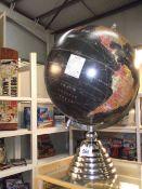 A Legend black globe on a chrome plated stand.