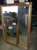 A large gilt framed mirror and one other.