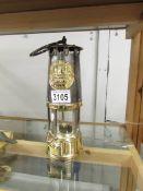 A brass miner's lamp.
