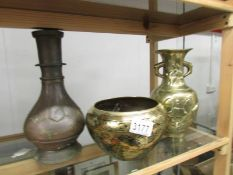 2 oriental brass vases and a brass jardiniere.