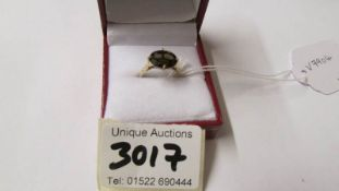 A 9ct gold ring (375) set amethyst coloured stone, size O, total 1.6 grams.