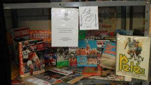 A large shelf of football memorabilia - England, America etc.