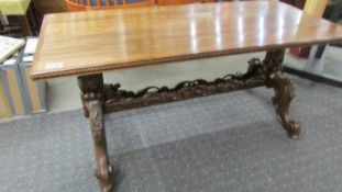 A good and solid oak coffee table on carved base.