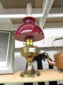 A brass Aladdin oil lamp.