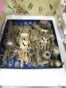 A box of brass and ormolu fittings.