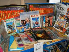 A large lot of Thunderbird books, puzzles etc.
