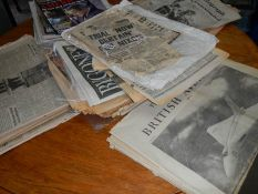 A large selection of contemporary newspapers headlining key event including 9/11, JFK assassination,