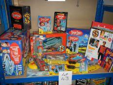 A shelf of Captain Scarlett toys including figures, DVD's etc.
