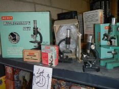 3 boxed collectable microscopes and 2 unboxed.