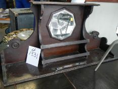 A shelf with cut glass mirror.