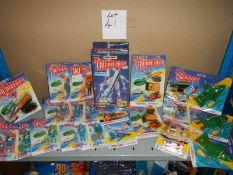 A large shelf of assorted Thunderbird toys,.