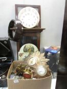 A large quantity of clock parts, empty case, faces and 2 starburst clocks,