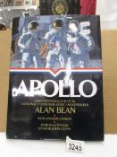 """An autographed copy of """"Apollo"""" book illustrated with astronaut Alan Bean's (4th man on the moon)"""