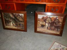 A pair of oak framed coaching pictures.