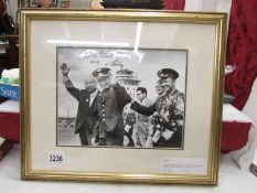 A framed and glazed Ahlomov photo of Titov with Krushchev and Gagarin, signed in his native Russian.