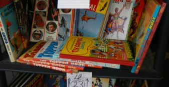 A shelf of assorted annuals including TV 21, Whizzer, TV Comic, Topper etc.