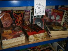 A shelf of Playboy magazines from 1980's, all in fair condition for age.