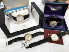 A boxed Tissot watch with book, another Tissot watch,
