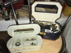 A shelf of cased jewellery
