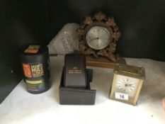 A carved wood mantle clock etc.
