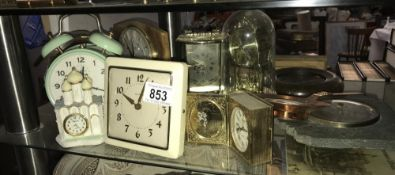 A selection of mantel clocks including carriage style