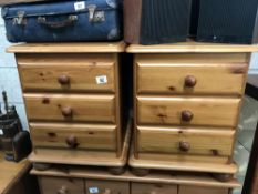 A pair of pine bedside 3 drawer cabinets