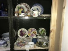 2 shelves of collectors plates & other items