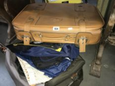 A suitcase, holdall with bags etc.