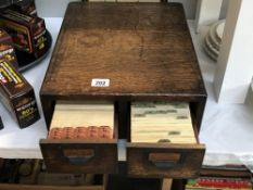 An Edwardian oak filing drawers