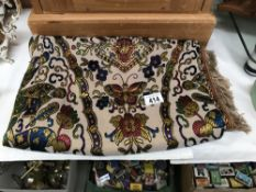 A Chinese style silk throw (Approximate size 136cm x 146cm not including the tassels)