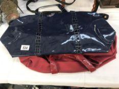 2 new Estee Lauder bags.