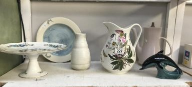 A Poole pottery plate, vase, dolphin, coffee pot,