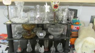 3 shelves of assorted glass ware.