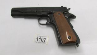A replica John Wayne 45 Government automatic armed forces commemorative gun.