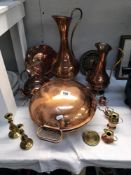 A selection of copper & brass ware including jugs kettle & candle sticks etc.