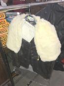 A fur coat and a fur cape.
