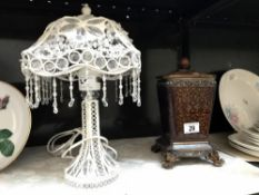 A decorative table lamp & a lidded urn