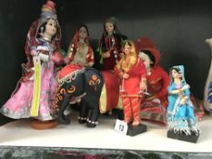 A quantity of costume dolls in Indian dress & an elephant