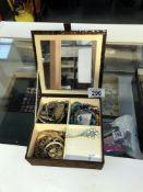 A jewellery box containing bracelets & earring etc.