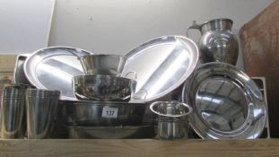 A mixed lot of stainless steel kitchen ware.