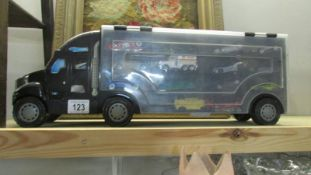 A lorry shaped carry case with cars.
