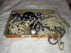 A mixed lot of necklaces
