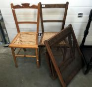 2 cane seated chairs & an antique day bed
