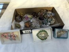 A mixed lot of costume brooches