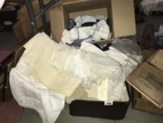 A suitcase full of interesting white linen