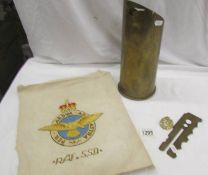 A quantity of militaria including old gun shell with R.A.F SSQ BIRD, R.A.F SSQ Embroidery, R.A.